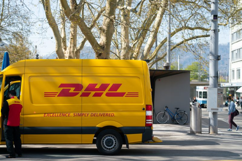 man-standing-in-front-of-DHL-truck-door